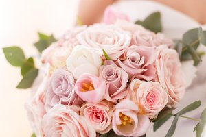 Brides bouquet of roses, tulips and eucalyptus