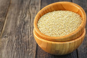 White quinoa in a wooden bowl.