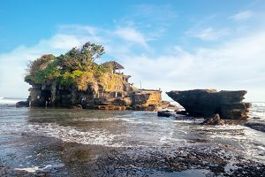 Scenic sea view near famous tourist landmark of Bali island - Tanah Lot - traditional Buddhist water temple attraction. Tropical nature landscape of Indonesia, Asia