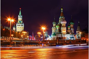 church and towers of Kremlin at night. view from Bolshoi Zamoskvoretsky bridge. Tracers from cars.