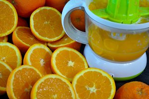 Juicer and half oranges