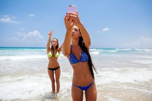 two sexy girls selfie photo on beach