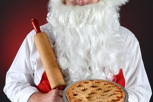 Santa Holding Pie and Rolling Pin