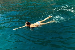 woman swim blue sea water lagoon