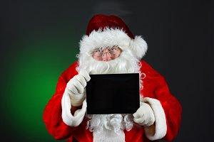 Santa Holding Tablet Computer