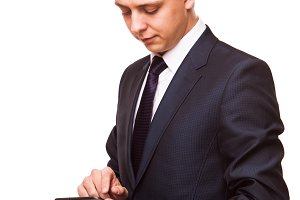 Young handsome businessman is working on his digital tablet isolated on white background