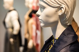 profile of white female mannequin in the showcase