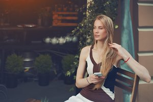 Pensive blonde lady in cafe