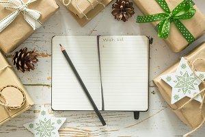 Making list of presents on wood