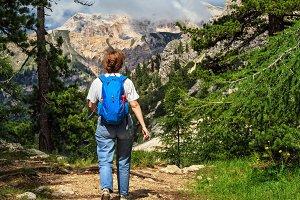 Dolomiti - hiker walks on alpine path