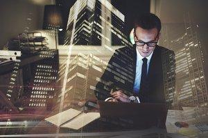 Optimistic businessman working on laptop