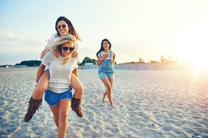 Three girls spending time on beach together