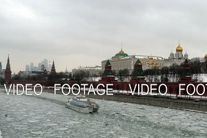 The Kremlin and a passing ship in the winter