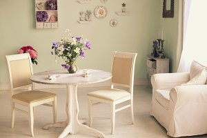 shabby chic dining room interior with flowers decorative plates
