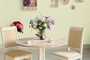 dining room interior with flowers decorative plates