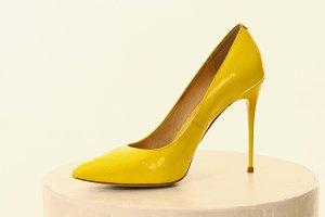 high heel yellow shoe