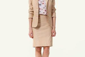 Woman Fashion Model in summer beige suite