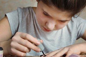 beautiful preteen girl make manicure