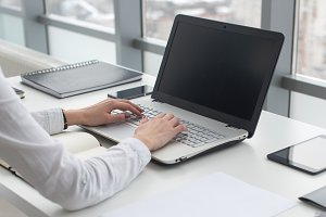 Businesswoman typing on laptop at workplace Woman working in office hand keyboard