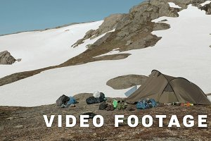 Tent in the snowy mountains. Smooth dolly shot