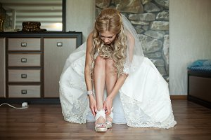 Bride raises her dress up