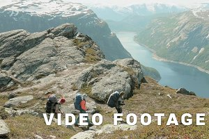 Backpackers go to the Trolltunga in Norway