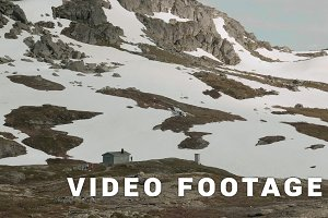 Helicopter takes off in the Norwegian mountains