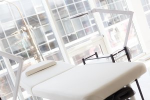 White table for massage and beauty procedures