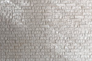 White brick wall with lines of light