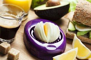 Egg slicer on table with breakfast setup