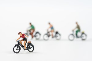 Miniature people cycling