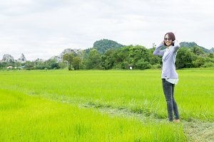 Woman standing in the rice fields.