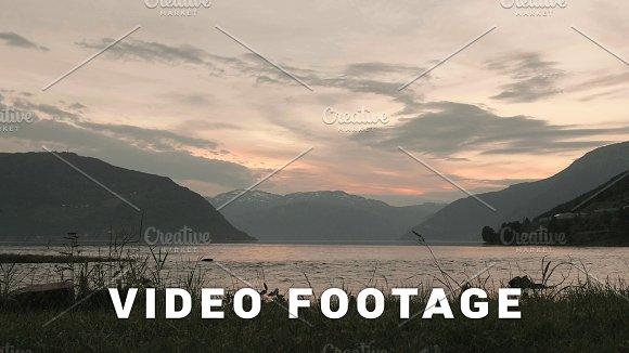 Sunset over the Norwegian fjord. Smooth slider shot