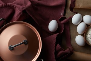 copper pan with eggs and flour