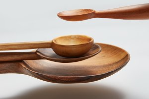different wood spoon isolated in air