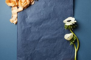 flowers with a black piece of paper