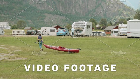 Young Girl Moves Canoe In The Camping Norway