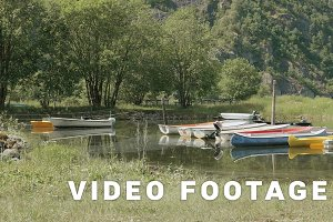 Boats, kayaks and canoes in the camping. Smooth dolly shot