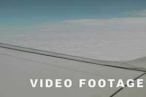 Airplane over the clouds