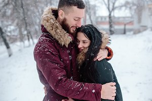 Young couple having fun on the snow