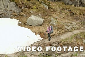 Girl hikes in mountains of Norway