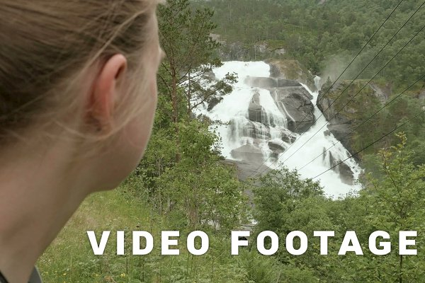 Girls look at waterfall in mountain…