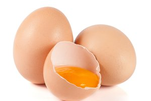 two whole eggs and broken egg isolated on white background