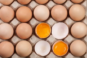 Eggs in the tray as a background. Top view