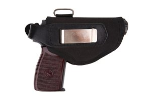 Gun in textile holster isolated