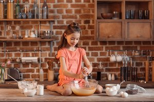 little girl baking pastry