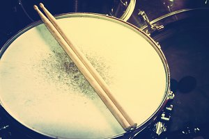 Music. Drum snare and drumsticks.
