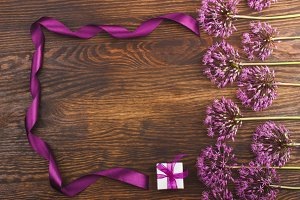Violet flowers and a box on the wooden board