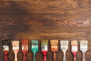 Different brushes on the wooden table