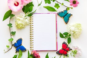Floral composition with notebook